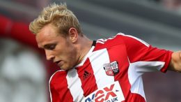 Brentford's Alex Pritchard, (left) battles for possession of the ball with OGC Nice's Eric Bautheac, (right)